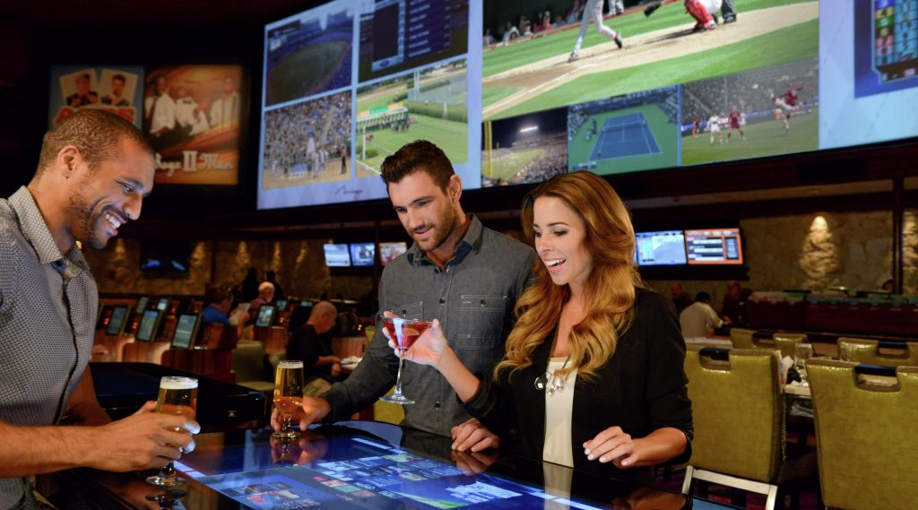 Patrons enjoy a drink at Mirage Casino during March Madness