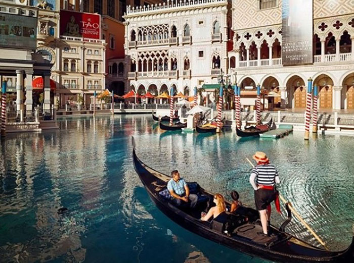 Visitors enjoying a gondola ride at the Venetian Resort.