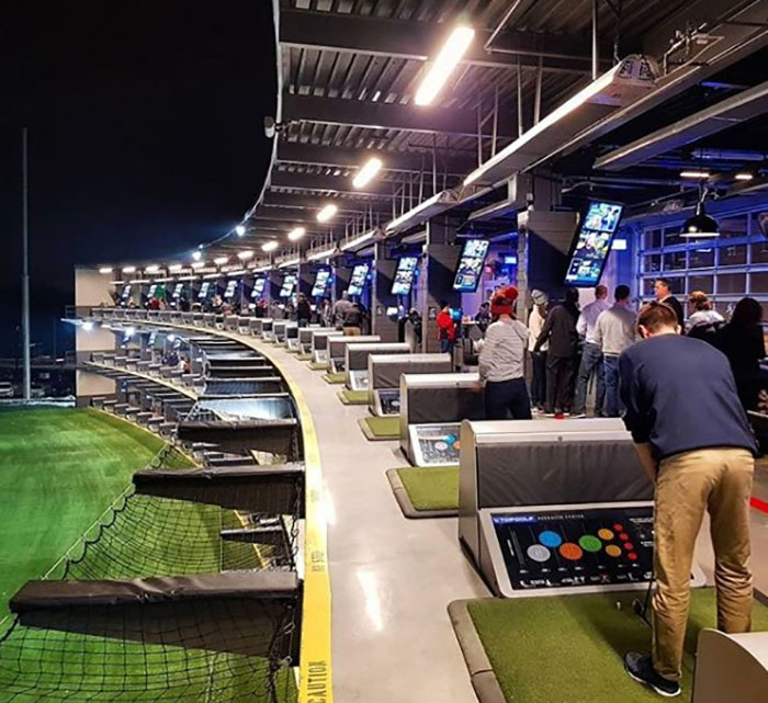 Golfers drive a few into the yard at MGM Grand, Topgolf in Las Vegas.