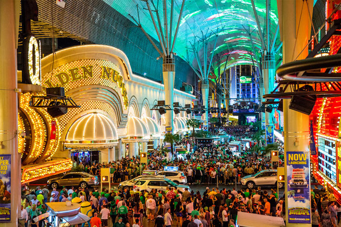 A packed Fremont Street during St. Patrick's Day in Vegas.