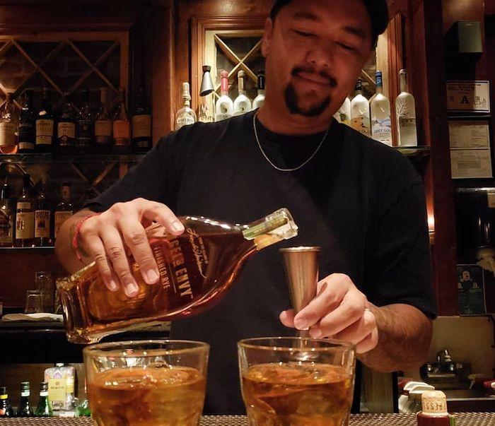 A bar tender pours a drink at the Griffin. Via Instagram: @lasvegasgriffin
