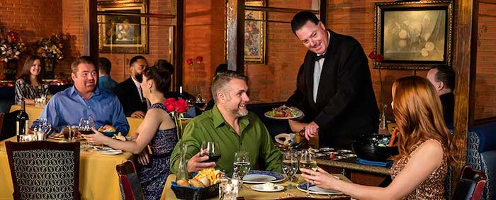 Diners enjoying themselves at Hugo's Cellar. Photo credit: fourqueens.com